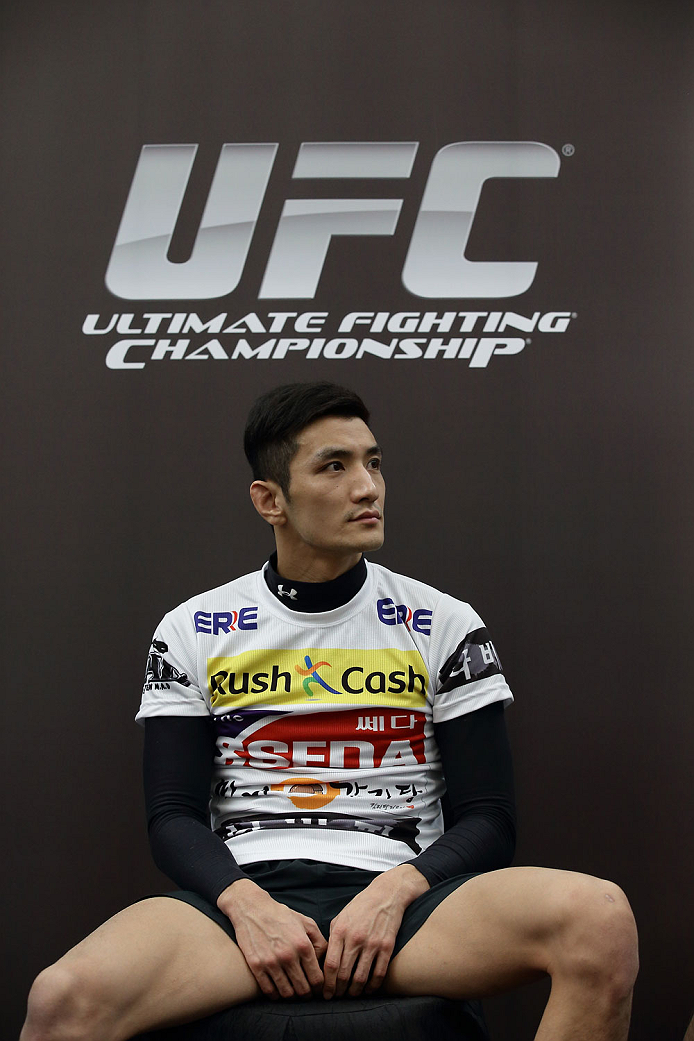 SINGAPORE - JANUARY 02:  Kyung Ho Kang attends the UFC Fight Night Singapore Ultimate Media Day at the Skating Rink at The Shoppes at Marina Bay Sand on January 2, 2014 in Singapore.  (Photo by Suhaimi Abdullah/Zuffa LLC)