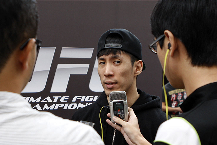 SINGAPORE - JANUARY 02:  Royston Wee interacts with media during the UFC Fight Night Singapore Ultimate Media Day at the Shoppes at Marina Bay Sands on January 2, 2014 in Singapore. (Photo by Mitch Viquez/Zuffa LLC/Zuffa LLC via Getty Images)