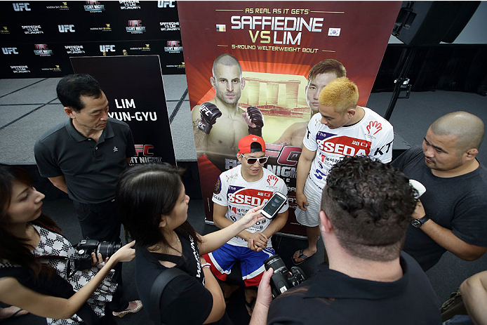 SINGAPORE - JANUARY 02:  Lim Hyun Gyu speaks to the media during the UFC Fight Night Singapore Ultimate Media Day at the Skating Rink at The Shoppes at Marina Bay Sand on January 2, 2014 in Singapore.  (Photo by Suhaimi Abdullah/Zuffa LLC)