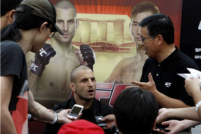 SINGAPORE - JANUARY 02:  Tarec Saffiedine interacts with media during the UFC Fight Night Singapore Ultimate Media Day at the Shoppes at Marina Bay Sands on January 2, 2014 in Singapore. (Photo by Mitch Viquez/Zuffa LLC/Zuffa LLC via Getty Images)