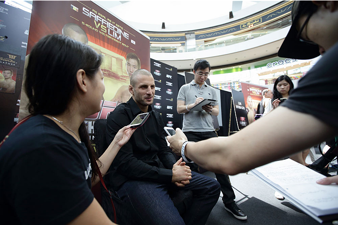 SINGAPORE - JANUARY 02:  Tarec Saffiedine speaks to the media during the UFC Fight Night Singapore Ultimate Media Day at the Skating Rink at The Shoppes at Marina Bay Sand on January 2, 2014 in Singapore.  (Photo by Suhaimi Abdullah/Zuffa LLC)