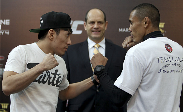 SINGAPORE - JANUARY 02:  (L-R) Opponents Royston Wee and David Galera face off during the UFC Fight Night Singapore Ultimate Media Day at the Shoppes at Marina Bay Sands on January 2, 2014 in Singapore. (Photo by Mitch Viquez/Zuffa LLC/Zuffa LLC via Getty Images)