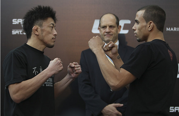 SINGAPORE - JANUARY 02:  (L-R) Opponents Tatsuya Kawajiri and Sean Soriano face off during the UFC Fight Night Singapore Ultimate Media Day at the Shoppes at Marina Bay Sands on January 2, 2014 in Singapore. (Photo by Mitch Viquez/Zuffa LLC/Zuffa LLC via Getty Images)