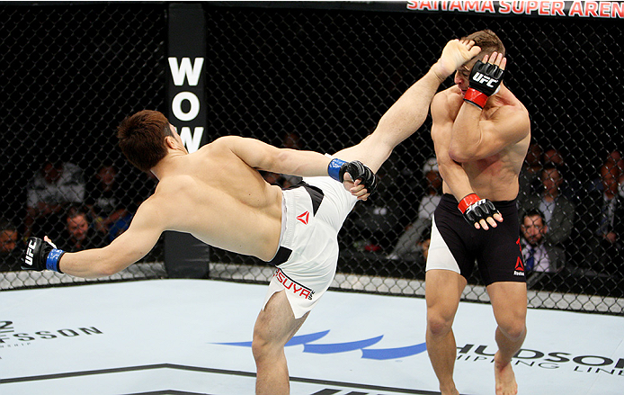 SAITAMA, JAPAN - SEPTEMBER 27:  Yusuke Kasuya of Japan kicks Nick Hein of Germany in their lightweight bout during the UFC event at the Saitama Super Arena on September 27, 2015 in Saitama, Japan. (Photo by Mitch Viquez/Zuffa LLC/Zuffa LLC via Getty Images)