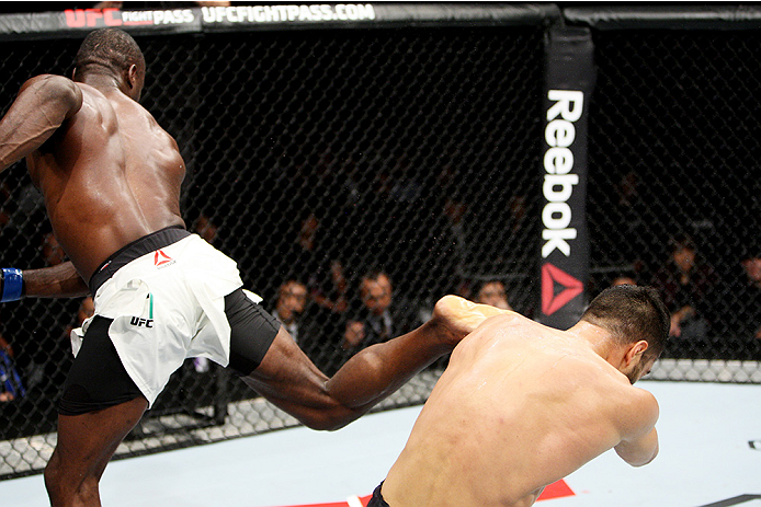 Uriah Hall lands a kick against Gegard Mousasi in their first fight in 2015