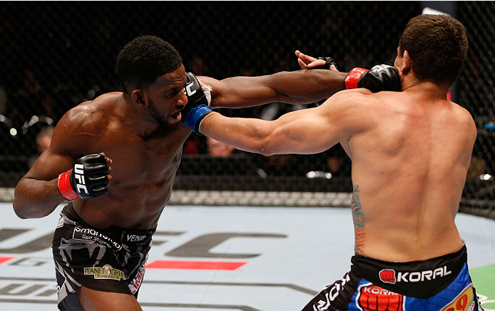 AUCKLAND, NEW ZEALAND - JUNE 28:  (L-R) Neil Magny punches Rodrigo de Lima in their welterweight fight during the UFC Fight Night event at Vector Arena on June 28, 2014 in Auckland, New Zealand.  (Photo by Josh Hedges/Zuffa LLC/Zuffa LLC via Getty Images)