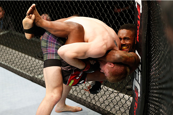 AUCKLAND, NEW ZEALAND - JUNE 28:  (R-L) Dashon Johnson attempts to secure a guillotine choke submission against Jake Matthews in their lightweight fight during the UFC Fight Night event at Vector Arena on June 28, 2014 in Auckland, New Zealand.  (Photo by Josh Hedges/Zuffa LLC/Zuffa LLC via Getty Images)