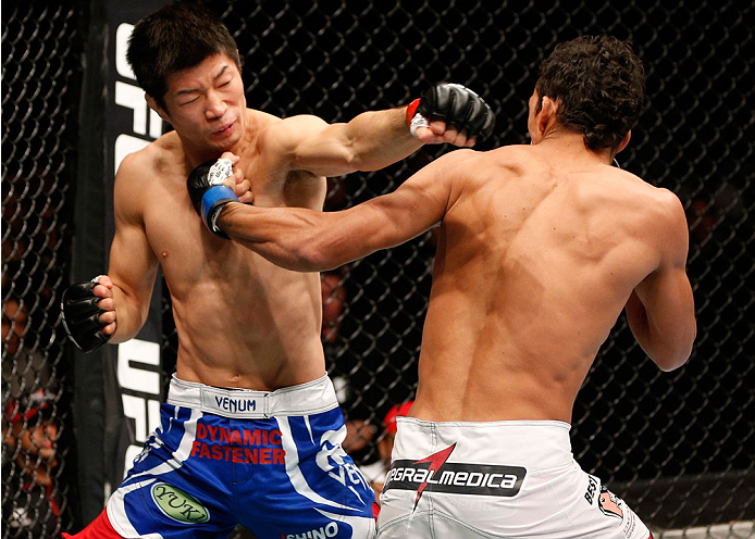 AUCKLAND, NEW ZEALAND - JUNE 28:  (R-L) Charles Oliveira punches Hatsu Hioki in their featherweight fight during the UFC Fight Night event at Vector Arena on June 28, 2014 in Auckland, New Zealand.  (Photo by Josh Hedges/Zuffa LLC/Zuffa LLC via Getty Images)