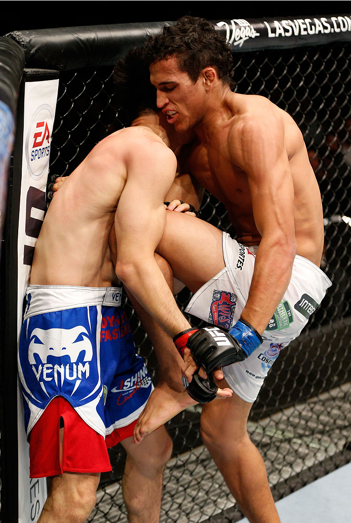 AUCKLAND, NEW ZEALAND - JUNE 28:  (R-L) Charles Oliveira knees Hatsu Hioki in their featherweight fight during the UFC Fight Night event at Vector Arena on June 28, 2014 in Auckland, New Zealand.  (Photo by Josh Hedges/Zuffa LLC/Zuffa LLC via Getty Images)