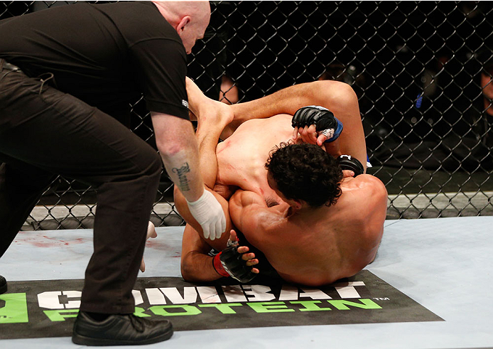 AUCKLAND, NEW ZEALAND - JUNE 28:  (R-L) Charles Oliveira secures a guillotine choke submission against Hatsu Hioki in their featherweight fight during the UFC Fight Night event at Vector Arena on June 28, 2014 in Auckland, New Zealand.  (Photo by Josh Hedges/Zuffa LLC/Zuffa LLC via Getty Images)