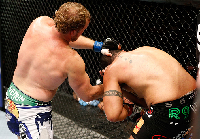 AUCKLAND, NEW ZEALAND - JUNE 28:  (L-R) Jared Rosholt punches Soa Palelei in their heavyweight fight during the UFC Fight Night event at Vector Arena on June 28, 2014 in Auckland, New Zealand.  (Photo by Josh Hedges/Zuffa LLC/Zuffa LLC via Getty Images)