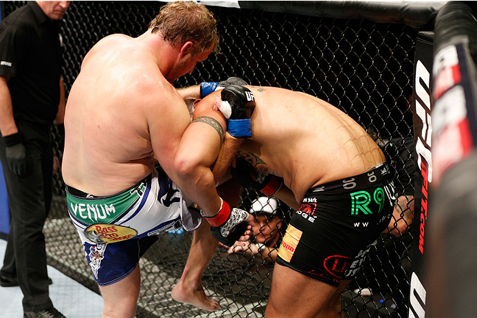 AUCKLAND, NEW ZEALAND - JUNE 28:  (L-R) Jared Rosholt knees Soa Palelei in their heavyweight fight during the UFC Fight Night event at Vector Arena on June 28, 2014 in Auckland, New Zealand.  (Photo by Josh Hedges/Zuffa LLC/Zuffa LLC via Getty Images)