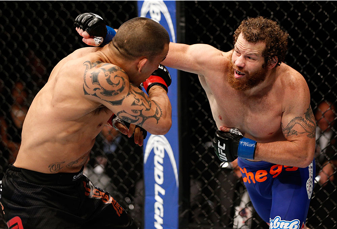 AUCKLAND, NEW ZEALAND - JUNE 28:  (R-L) Nate Marquardt punches James Te Huna in their middleweight fight during the UFC Fight Night event at Vector Arena on June 28, 2014 in Auckland, New Zealand.  (Photo by Josh Hedges/Zuffa LLC/Zuffa LLC via Getty Images)