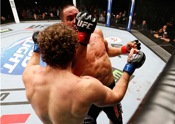 AUCKLAND, NEW ZEALAND - JUNE 28:  (R-L) James Te Huna punches Nate Marquardt in their middleweight fight during the UFC Fight Night event at Vector Arena on June 28, 2014 in Auckland, New Zealand.  (Photo by Josh Hedges/Zuffa LLC/Zuffa LLC via Getty Images)