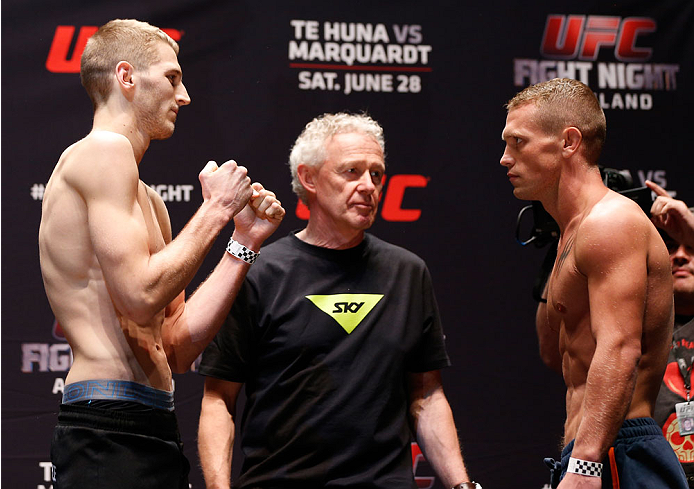 AUCKLAND, NEW ZEALAND - JUNE 27:  (L-R) Opponents Dan Hooker and Ian Entwistle face off during the UFC weigh-in at Vector Arena on June 27, 2014 in Auckland, New Zealand.  (Photo by Josh Hedges/Zuffa LLC/Zuffa LLC via Getty Images)