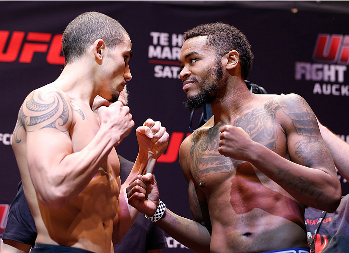 AUCKLAND, NEW ZEALAND - JUNE 27:  (L-R) Opponents Robert Whittaker and Mike Rhodes face off during the UFC weigh-in at Vector Arena on June 27, 2014 in Auckland, New Zealand.  (Photo by Josh Hedges/Zuffa LLC/Zuffa LLC via Getty Images)