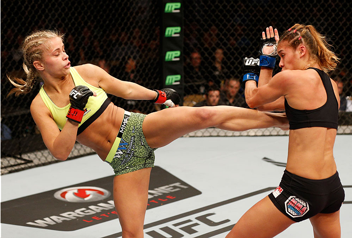 AUSTIN, TX - NOVEMBER 22: (L-R) Paige VanZant kicks Kailin Curran in their women's bantamweight bout during the UFC Fight Night event at The Frank Erwin Center on November 22, 2014 in Austin, Texas. (Photo by Josh Hedges/Zuffa LLC/Zuffa LLC via Getty Images)