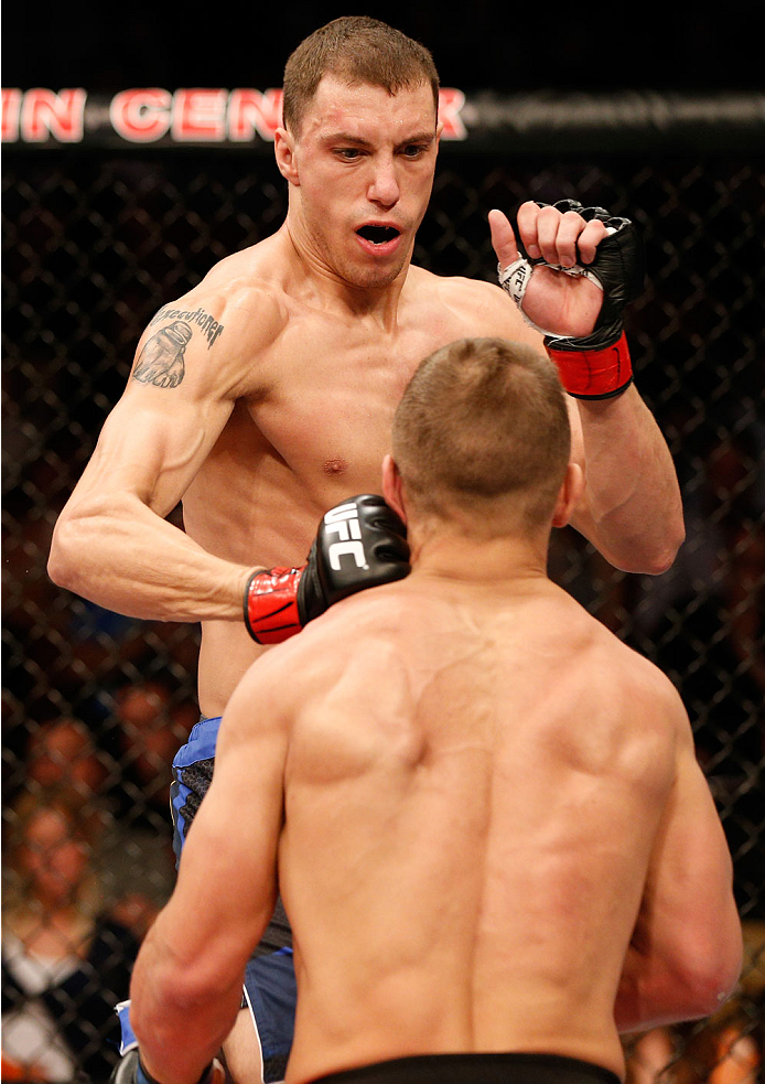 AUSTIN, TX - NOVEMBER 22:  (L-R) James Vick punches Nick Hein of Germany in their lightweight bout during the UFC Fight Night event at The Frank Erwin Center on November 22, 2014 in Austin, Texas.  (Photo by Josh Hedges/Zuffa LLC/Zuffa LLC via Getty Images)