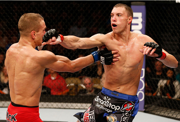 AUSTIN, TX - NOVEMBER 22:  (R-L) James Vick punches Nick Hein of Germany in their lightweight bout during the UFC Fight Night event at The Frank Erwin Center on November 22, 2014 in Austin, Texas.  (Photo by Josh Hedges/Zuffa LLC/Zuffa LLC via Getty Images)