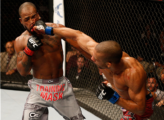 Edson Barboza of Brazil punches Bobby Green in their lightweight bout during the UFC Fight Night event at The Frank Erwin Center on November 22, 2014 in Austin, TX. (Photo by Josh Hedges/Zuffa LLC)