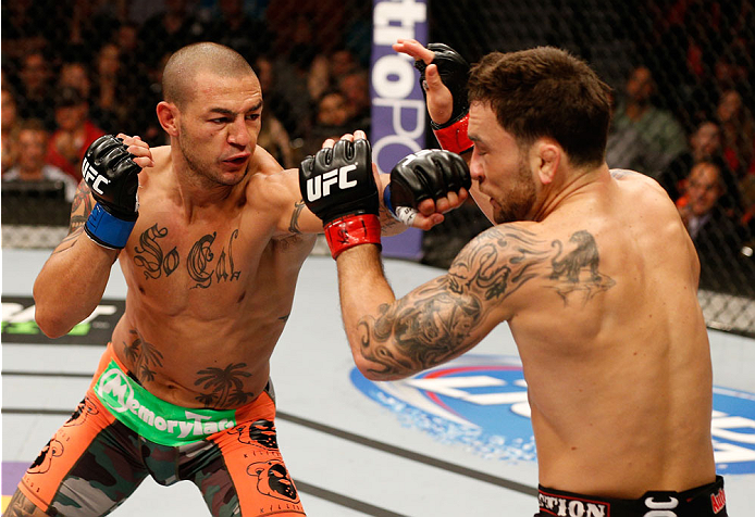 AUSTIN, TX - NOVEMBER 22:  (L-R) Cub Swanson punches Frankie Edgar in their featherweight bout during the UFC Fight Night event at The Frank Erwin Center on November 22, 2014 in Austin, Texas.  (Photo by Josh Hedges/Zuffa LLC/Zuffa LLC via Getty Images)