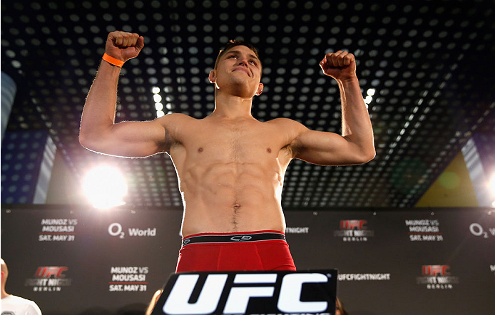 BERLIN, GERMANY - MAY 30:  Drew Dober poses on the scale during the UFC weigh-in at O2 World on May 30, 2014 in Berlin, Germany.  (Photo by Boris Streubel/Zuffa LLC/Zuffa LLC via Getty Images)