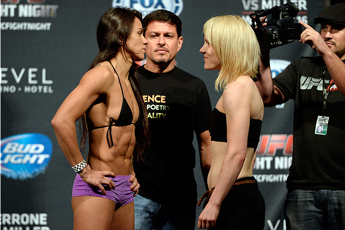 ATLANTIC CITY, NJ - JULY 15:  Claudia Gadelha (L) and Tina Lahdemaki face off during the UFC Fight Night weigh-in at Revel Casino on July 15, 2014 in Atlantic City, New Jersey.  (Photo by Jeff Bottari/Zuffa LLC/Zuffa LLC via Getty Images)