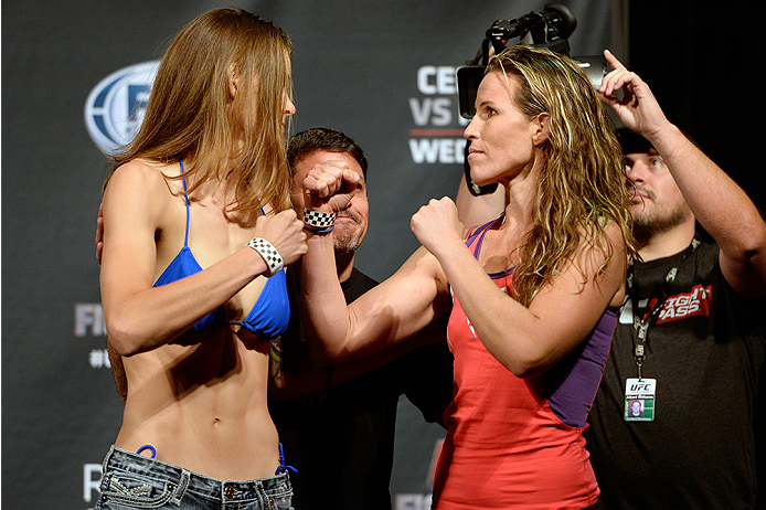 ATLANTIC CITY, NJ - JULY 15:  Jessamyn Duke (L) and Leslie Smith face off during the UFC Fight Night weigh-in at Revel Casino on July 15, 2014 in Atlantic City, New Jersey.  (Photo by Jeff Bottari/Zuffa LLC/Zuffa LLC via Getty Images)