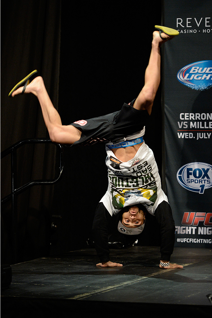 ATLANTIC CITY, NJ - JULY 15:  John Lineker cartwheels on stage during the UFC Fight Night weigh-in at Revel Casino on July 15, 2014 in Atlantic City, New Jersey.  (Photo by Jeff Bottari/Zuffa LLC/Zuffa LLC via Getty Images)