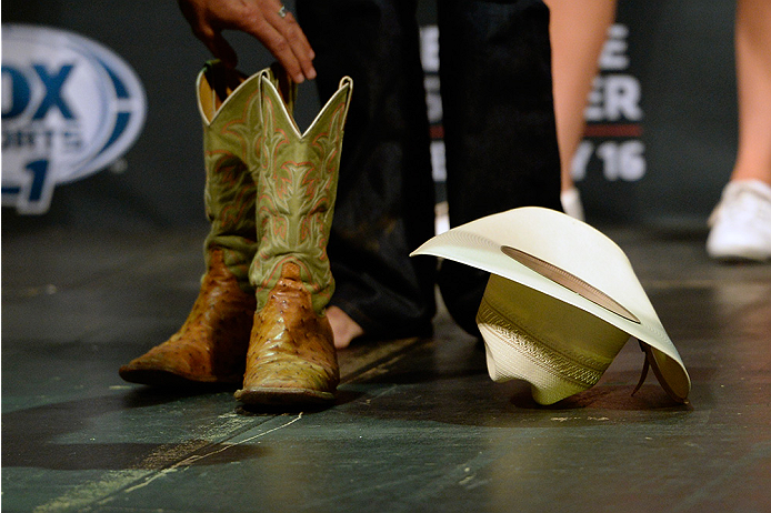 "ATLANTIC CITY, NJ - JULY 15:  A detail shot of Donald ""Cowboy"" Cerrone's boots and hat as they lay on the stage as he steps on the scale during the UFC Fight Night weigh-in at Revel Casino on July 15, 2014 in Atlantic City, New Jersey.  (Photo by Jeff Bottari/Zuffa LLC/Zuffa LLC via Getty Images)"