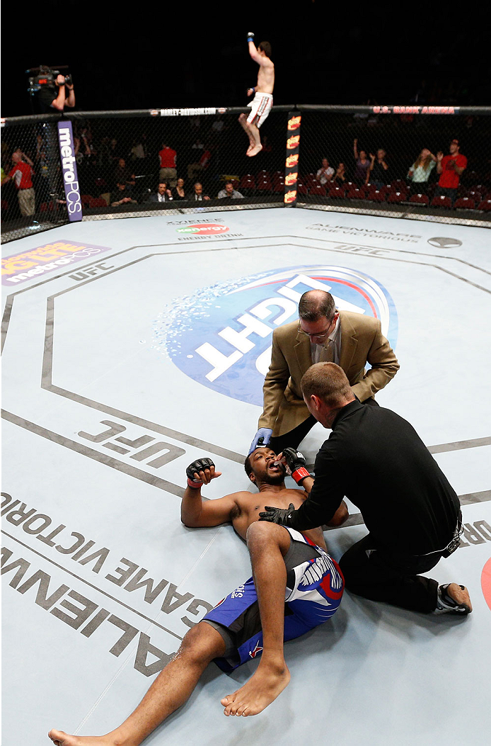 CINCINNATI, OH - MAY 10:  Anthony Lapsley lays on the canvas after his knockout loss to Albert Tumenov in their welterweight fight during the UFC Fight Night event at the U.S. Bank Arena on May 10, 2014 in Cincinnati, Ohio. (Photo by Josh Hedges/Zuffa LLC/Zuffa LLC via Getty Images)