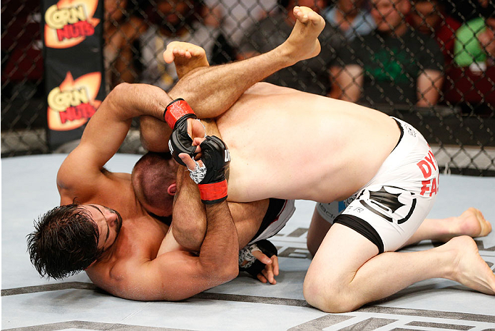 CINCINNATI, OH - MAY 10:  (L-R) Yan Cabral attempts a triangle choke submission against Zak Cummings in their welterweight fight during the UFC Fight Night event at the U.S. Bank Arena on May 10, 2014 in Cincinnati, Ohio. (Photo by Josh Hedges/Zuffa LLC/Zuffa LLC via Getty Images)