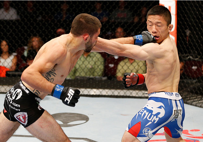 CINCINNATI, OH - MAY 10:  (L-R) Darrell Montague and Kyoji Horiguchi trade punches in their flyweight fight during the UFC Fight Night event at the U.S. Bank Arena on May 10, 2014 in Cincinnati, Ohio. (Photo by Josh Hedges/Zuffa LLC/Zuffa LLC via Getty Images)