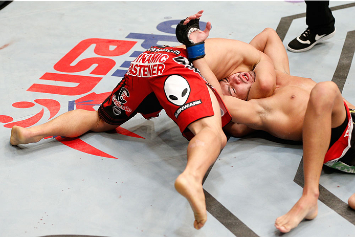 CINCINNATI, OH - MAY 10:  (L-R) Chris Cariaso attempts to secure a choke against Louis Smolka in their flyweight fight during the UFC Fight Night event at the U.S. Bank Arena on May 10, 2014 in Cincinnati, Ohio. (Photo by Josh Hedges/Zuffa LLC/Zuffa LLC via Getty Images)