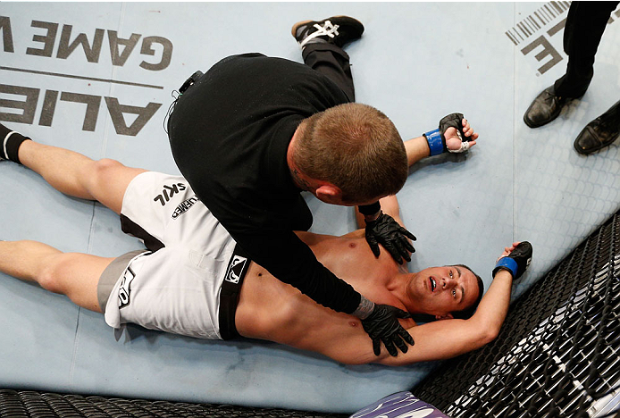CINCINNATI, OH - MAY 10: Ruan Potts lays on the canvas after his knockout loss to Soa Palelei in their heavyweight fight during the UFC Fight Night event at the U.S. Bank Arena on May 10, 2014 in Cincinnati, Ohio. (Photo by Josh Hedges/Zuffa LLC/Zuffa LLC via Getty Images)