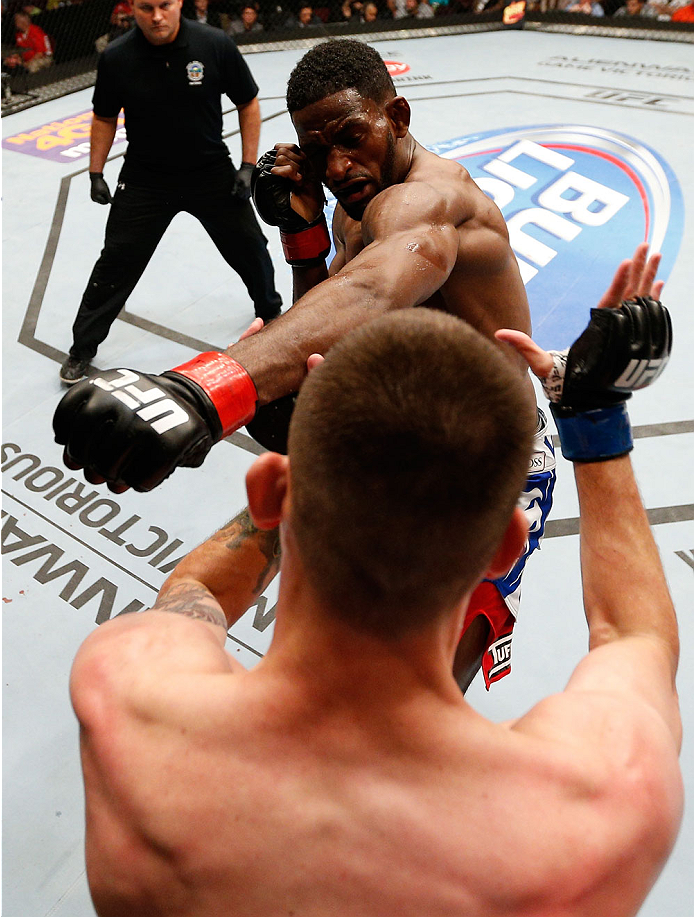 CINCINNATI, OH - MAY 10:  (R-L) Neil Magny punches Tim Means in their welterweight fight during the UFC Fight Night event at the U.S. Bank Arena on May 10, 2014 in Cincinnati, Ohio. (Photo by Josh Hedges/Zuffa LLC/Zuffa LLC via Getty Images)