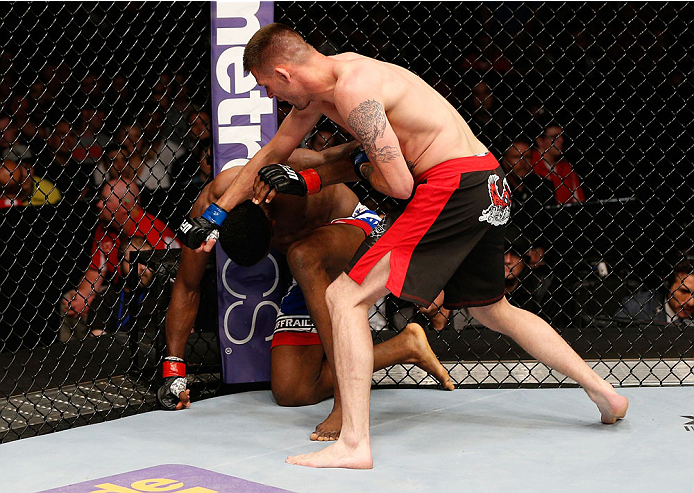 CINCINNATI, OH - MAY 10:  (R-L) Tim Means punches Neil Magny in their welterweight fight during the UFC Fight Night event at the U.S. Bank Arena on May 10, 2014 in Cincinnati, Ohio. (Photo by Josh Hedges/Zuffa LLC/Zuffa LLC via Getty Images)