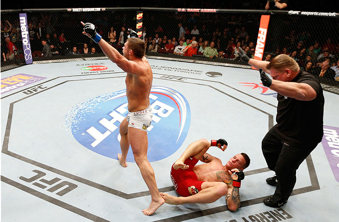 CINCINNATI, OH - MAY 10: Daron Cruickshank (L) reacts after his knockout victory over Erik Koch in their lightweight fight during the UFC Fight Night event at the U.S. Bank Arena on May 10, 2014 in Cincinnati, Ohio. (Photo by Josh Hedges/Zuffa LLC/Zuffa LLC via Getty Images)