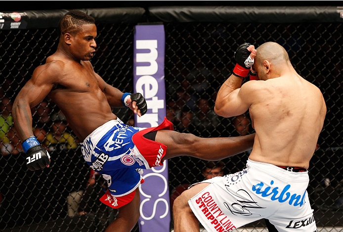 CINCINNATI, OH - MAY 10: (L-R) Lorenz Larkin kicks Costas Philippou in their middleweight fight during the UFC Fight Night event at the U.S. Bank Arena on May 10, 2014 in Cincinnati, Ohio. (Photo by Josh Hedges/Zuffa LLC/Zuffa LLC via Getty Images)