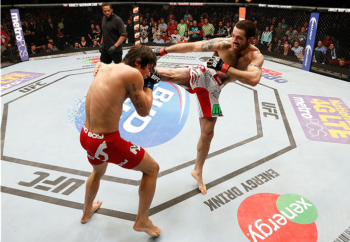 CINCINNATI, OH - MAY 10:  (R-L) Matt Brown kicks Erick Silva in their welterweight fight during the UFC Fight Night event at the U.S. Bank Arena on May 10, 2014 in Cincinnati, Ohio. (Photo by Josh Hedges/Zuffa LLC/Zuffa LLC via Getty Images)