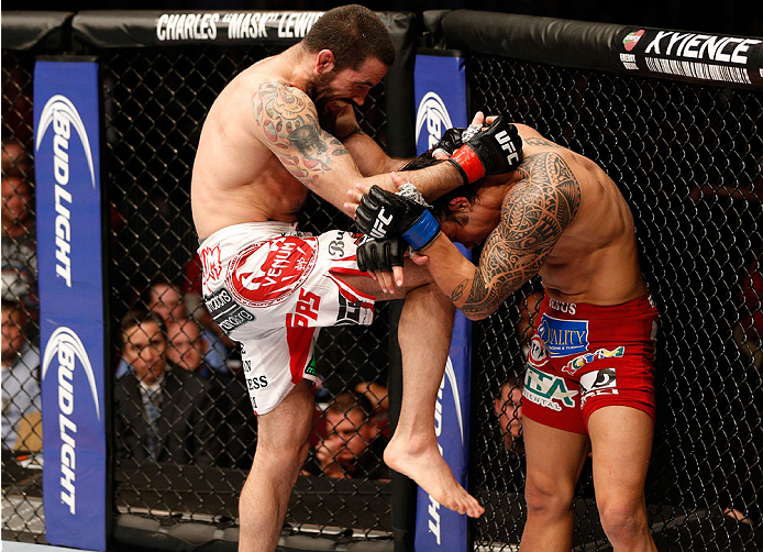 CINCINNATI, OH - MAY 10:  (L-R) Matt Brown knees Erick Silva in their welterweight fight during the UFC Fight Night event at the U.S. Bank Arena on May 10, 2014 in Cincinnati, Ohio. (Photo by Josh Hedges/Zuffa LLC/Zuffa LLC via Getty Images)