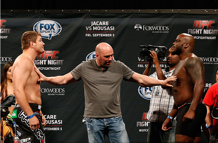 MASHANTUCKET, CT - SEPTEMBER 04:  Heavyweight opponents Matt Mitrione (L) and Derrick Lewis (R) are separated by UFC President Dana White during the UFC Fight Night weigh-in at Foxwoods Resort Casino on September 4, 2014 in Mashantucket, Connecticut.  (Photo by Josh Hedges/Zuffa LLC/Zuffa LLC via Getty Images)