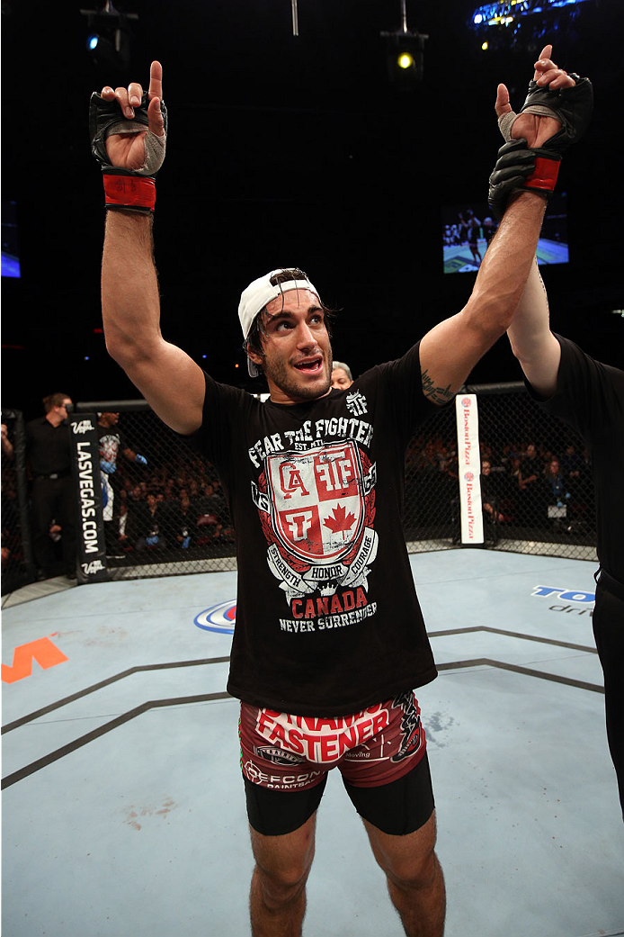 HALIFAX, NS - OCTOBER 4:  Elias Theodorou of Canada celebrates after defeating Bruno Santos of Brazil in their middleweight bout at the Scotiabank Centre on October 4, 2014 in Halifax, Nova Scotia, Canada. (Photo by Nick Laham/Zuffa LLC/Zuffa LLC via Getty Images)
