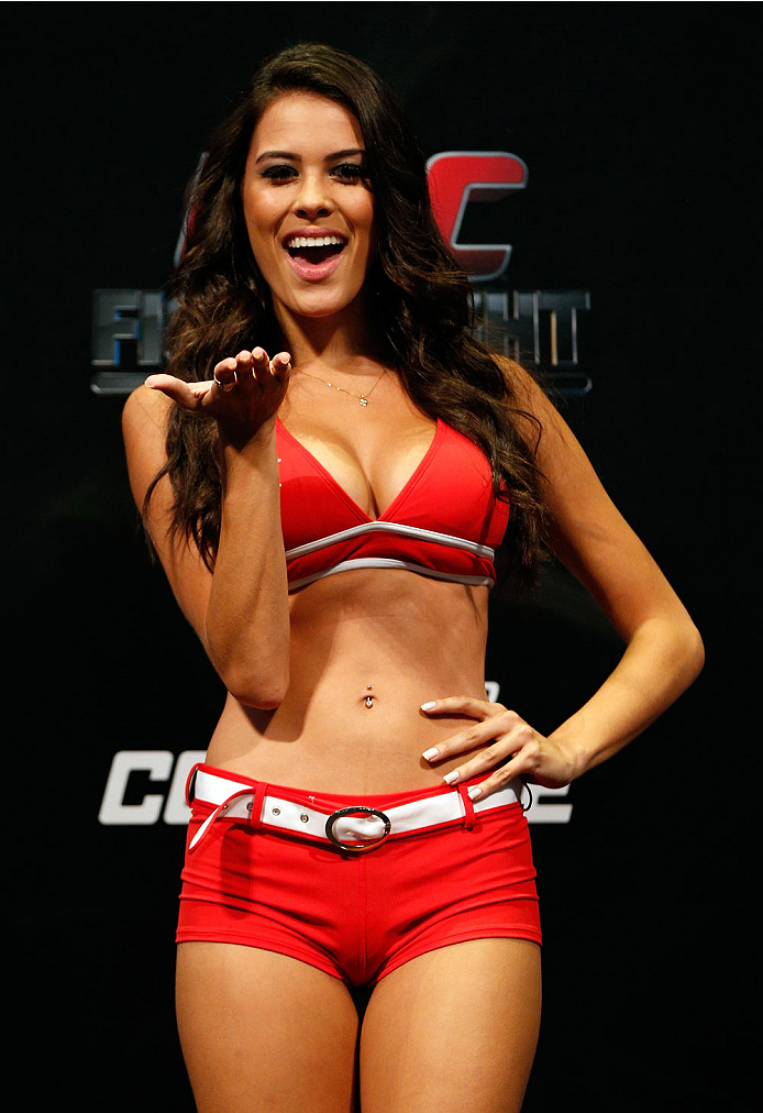 JARAGUA DO SUL, BRAZIL - FEBRUARY 14:  UFC Octagon Girl Camila Rodrigues de Oliveira stands on stage during the UFC weigh-in at Arena Jaragua on February 14, 2014 in Jaragua do Sul, Santa Catarina, Brazil. (Photo by Josh Hedges/Zuffa LLC/Zuffa LLC via Getty Images)