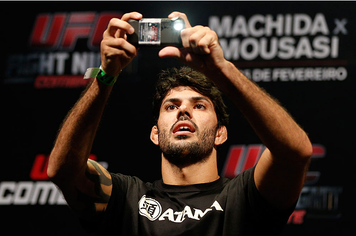 JARAGUA DO SUL, BRAZIL - FEBRUARY 14:  Viscardi Andrade takes a photo of the crowd before stepping on the scale during the UFC weigh-in at Arena Jaragua on February 14, 2014 in Jaragua do Sul, Santa Catarina, Brazil. (Photo by Josh Hedges/Zuffa LLC/Zuffa LLC via Getty Images)