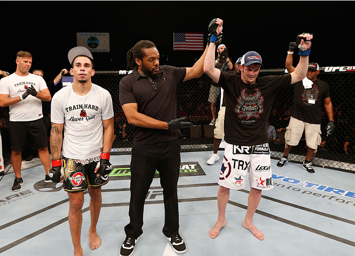 MASHANTUCKET, CT - SEPTEMBER 05: Chas Skelly (R) celebrates after his unanimous-decision victory over Sean Soriano in their featherweight bout during the UFC Fight Night event at Foxwoods Resort Casino on September 5, 2014 in Mashantucket, Connecticut. (Photo by Josh Hedges/Zuffa LLC/Zuffa LLC via Getty Images)
