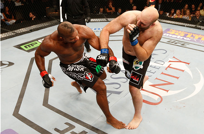 MASHANTUCKET, CT - SEPTEMBER 05:  (R-L) Ben Rothwell lands an overhand right to the head of Alistair Overeem in their heavyweight bout during the UFC Fight Night event at Foxwoods Resort Casino on September 5, 2014 in Mashantucket, Connecticut.  (Photo by Josh Hedges/Zuffa LLC/Zuffa LLC via Getty Images)