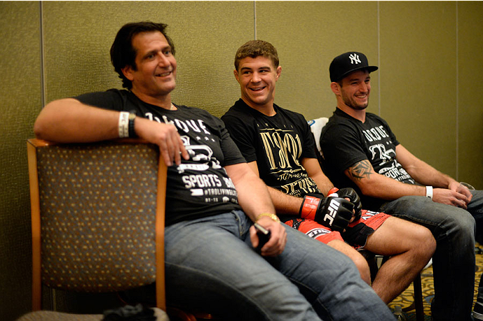 MASHANTUCKET, CT - SEPTEMBER 5:  Coach and trainer Ray Longo (L) and Al Iaquinta (C) rest backstage during the UFC Fight Night event inside the Grand Theatre at Foxwoods Resort Casino on September 5, 2014 in Mashantucket, Connecticut. (Photo by Jeff Bottari/Zuffa LLC/Zuffa LLC via Getty Images)