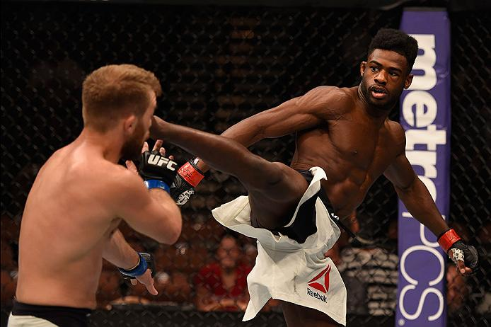 LAS VEGAS, NV - MAY 29: (R-L) Aljamain Sterling kicks Bryan Caraway in their bantamweight bout during the UFC Fight Night event inside the Mandalay Bay Events Center on May 29, 2016 in Las Vegas, Nevada. (Photo by Josh Hedges/Zuffa LLC)