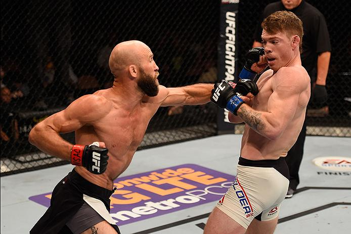 LAS VEGAS, NV - MAY 29: (L-R) Joshua Burkman punches Paul Felder in their lightweight bout during the UFC Fight Night event inside the Mandalay Bay Events Center on May 29, 2016 in Las Vegas, Nevada.  (Photo by Josh Hedges/Zuffa LLC/Zuffa LLC via Getty Images) *** Local Caption *** Joshua Burkman; Paul Felder